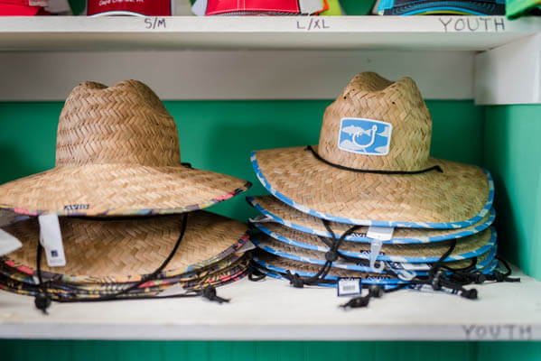 Stacks of beach hats in a store