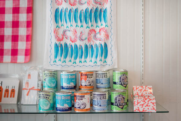Colorful cans of oysters placed on a shelf in store