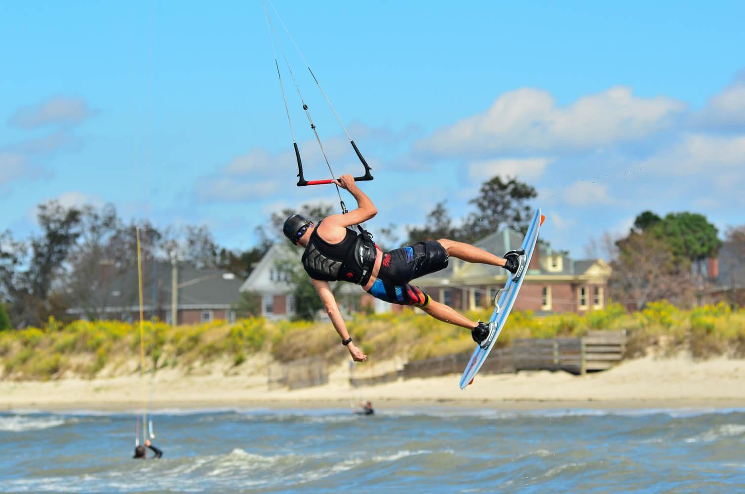 Man windsurfing near beach