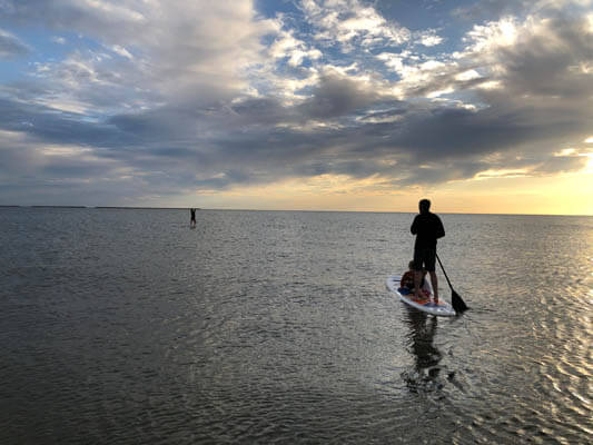 Two people on a paddle board on the sea